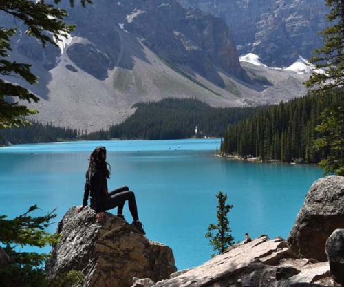 YMAL-CARIBOU-moraine-lake-solo-female-rock-pose
